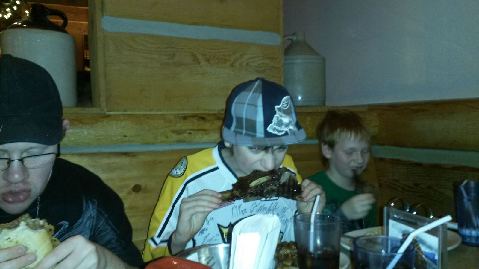 Tristan eating ribs at Montanans